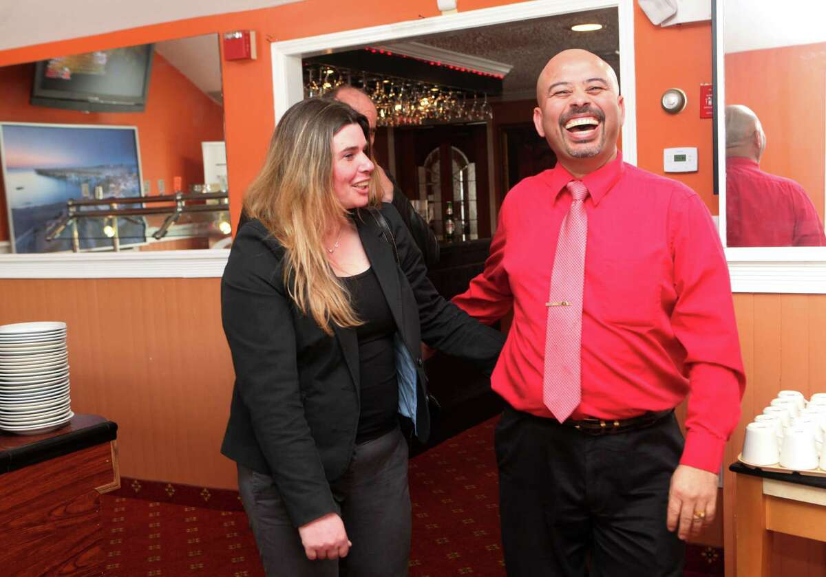 Co owner Pramod Kandel, right, welcomes guests to Baingan Indian restaurant in Shelton, Conn. on Sunday, May 4, 2014.
