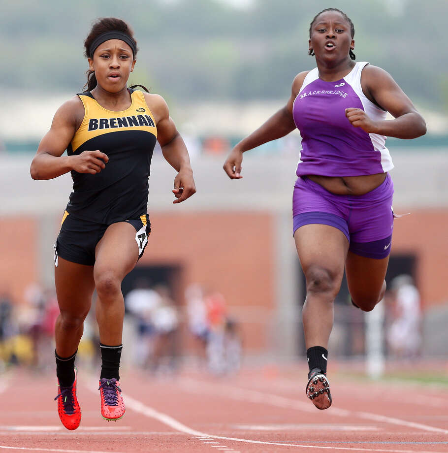 Brennan's Deana Richardson, left, races to the finish line with Brackenridge's Tevis Thomas in the 4A 100-meter run at the regional meet at Heroes Stadium on April 26. Less than half a second divided first and second place. Richardson took 12.26 seconds; Thomas came in with 12.41. Thomas is going to state for the second time in her high school career. Photo: Marvin Pfeiffer / Southside Reporter / Express-News 2014