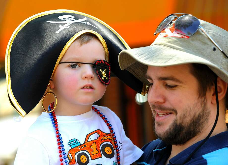 The Dread Pirate Louis:Three-year-old Louis Wilcox enjoys some arr and arr with   dad Jim at the Isle of Eight Flags Shrimp Festival in Fernandina Beach, Fla. Pirate garb   is de rigueur for the shrimp fest. Photo: Bob Mack, Associated Press