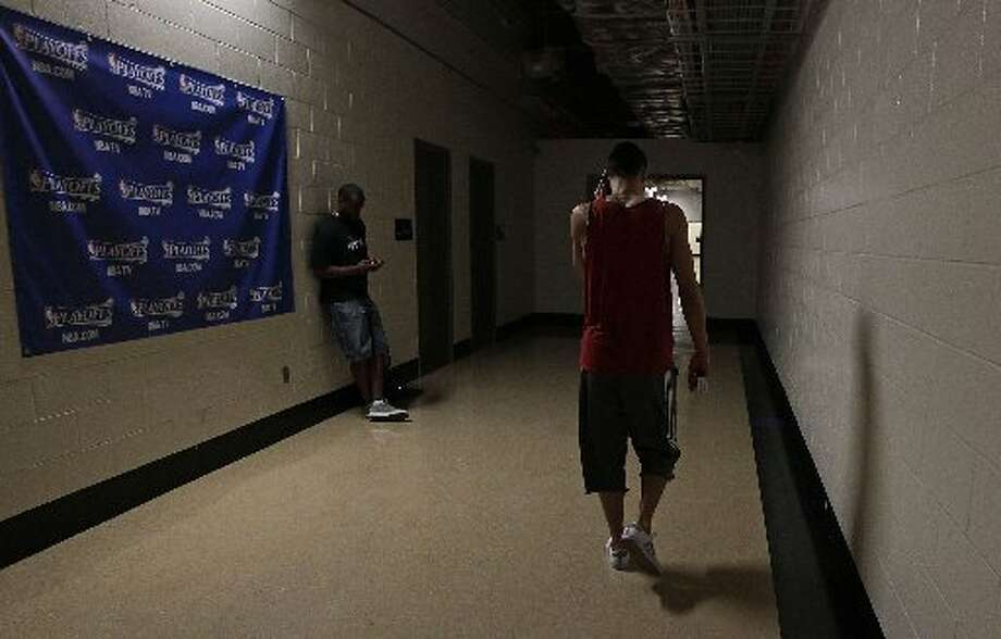 Jeremy Lin leaves after his exit interview. Photo: James Nielsen, Houston Chronicle