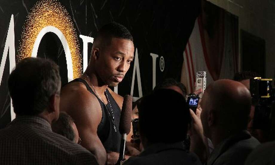 Dwight Howard speaks with reporters. Photo: James Nielsen, Houston Chronicle