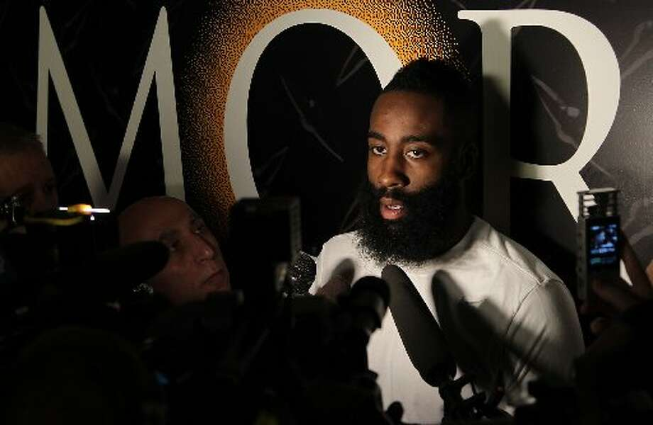 James Harden speaks with reporters. Photo: James Nielsen, Houston Chronicle