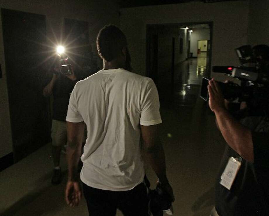 James Harden leaves after his exit interview. Photo: James Nielsen, Houston Chronicle