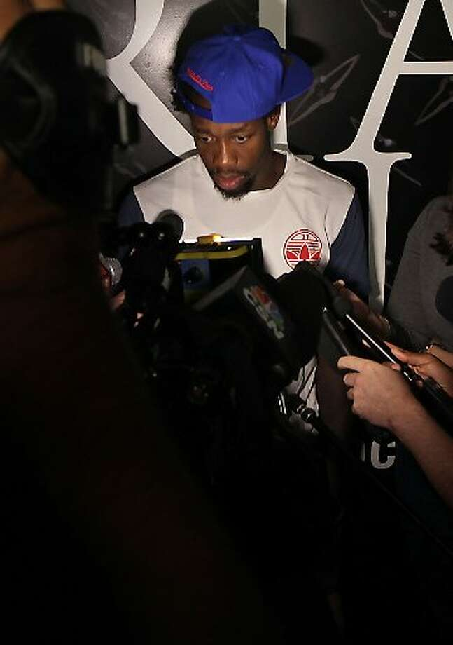 Pat Beverley speaks with reporters. Photo: James Nielsen, Houston Chronicle