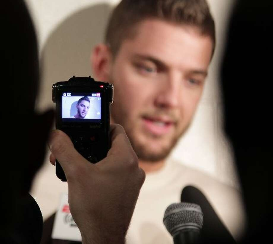 Chandler Parsons speaks to reporters. Photo: James Nielsen, Houston Chronicle