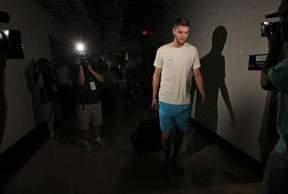 Chandler Parsons leaves after his exit interview. Photo: James Nielsen, Houston Chronicle