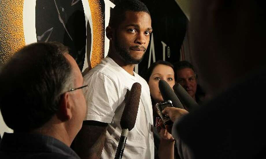 Troy Daniels speaks to reporters. Photo: James Nielsen, Houston Chronicle