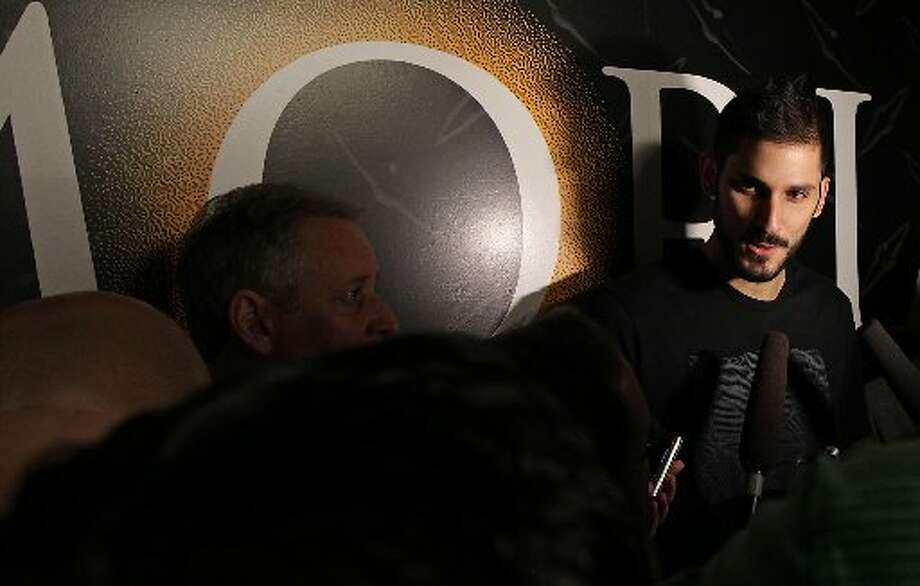 Omri Casspi speaks to reporters. Photo: James Nielsen, Houston Chronicle