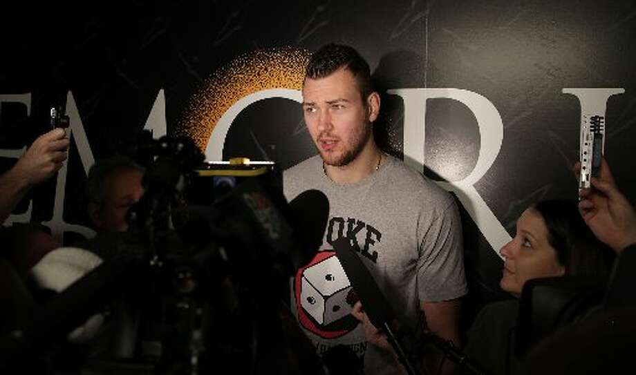 Donatas Motiejunas speaks to reporters. Photo: James Nielsen, Houston Chronicle