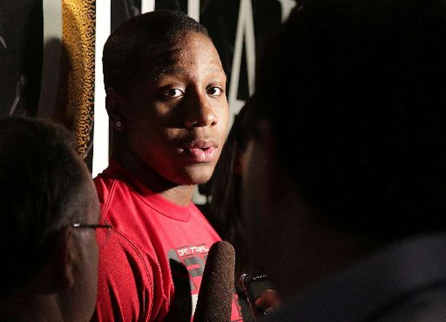 Isaiah Canaan speaks with reporters. Photo: James Nielsen, Houston Chronicle