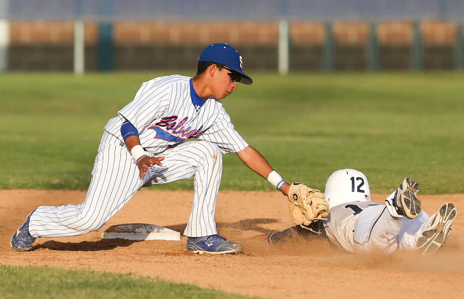 South San's Jaren Gamez, left, tags out O'Connor's Drew Fields at second base during the second inning of their Class 5A bidistrict playoff game Friday. O'Connor won. Photo: Marvin Pfeiffer / Southside Reporter / EN Communities 2014