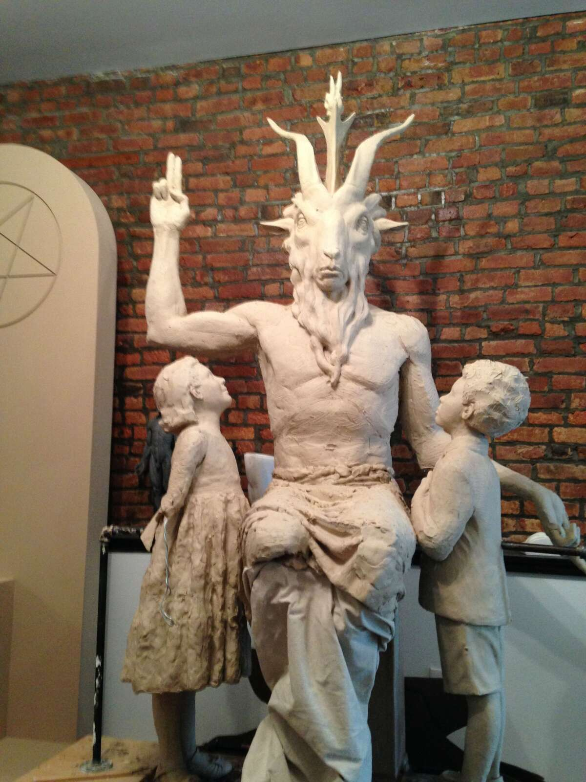 Ground zero for Satan vs. Moses New York-based Satanic Temple wants to put a 7-foot-tall statue at the Oklahoma state Capitol, where a Ten Commandments monument was placed in 2012.In the latest update, the Capitol Preservation Commission has declared a moratorium on any more monuments, after it got requests from a Hindu group, People for the Ethical Treatment of Animals, and the Church of the Flying Spaghetti Monster.The commission has said it's waiting for the ACLU suit over the Ten Commandments monument to be resolved.