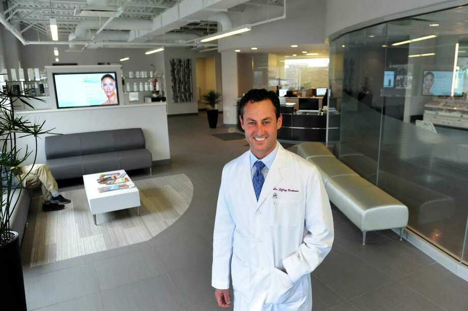 Dr. Jeffrey Rockmore in the newly-remodeled waiting area on Tuesday, April 29, 2014, at The Plastic Surgery Group in Albany, N.Y. (Cindy Schultz / Times Union) Photo: Cindy Schultz / 00026666A