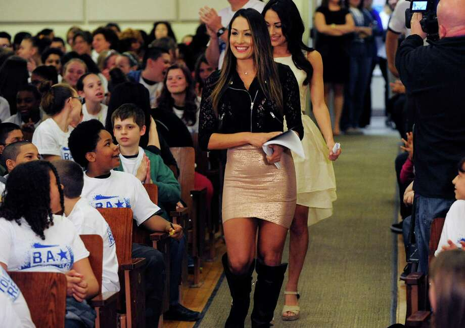 Students cheer as the WWE Divas Nikki, foreground, and Brie Bella enter at the start of the Be a STAR anti-bullying rally Monday, May 5, 2014, at Central Park Middle School in Schenectady, N.Y.  Several WWE personalities took part in the rally to help educated kids about the types of bullying and how to work as a team to help stop bullying.  The program was founded by The Creative Coalition and WWE.  (Paul Buckowski / Times Union) Photo: Paul Buckowski / 00026735A