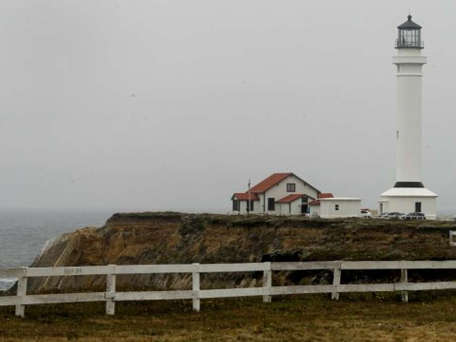Point Arena Lighthouse, Point Arena The lodgings are simple, but the experience is exceptional. If it's foggy, cozy up near the wood-burning fireplace in your room; if it's blue skies, watch the sun set from the cliffs. Either way, a climb up the 140 plus steps to the top of the West Coast's tallest lighthouse is a must.  Photo: Brant Ward, The Chronicle