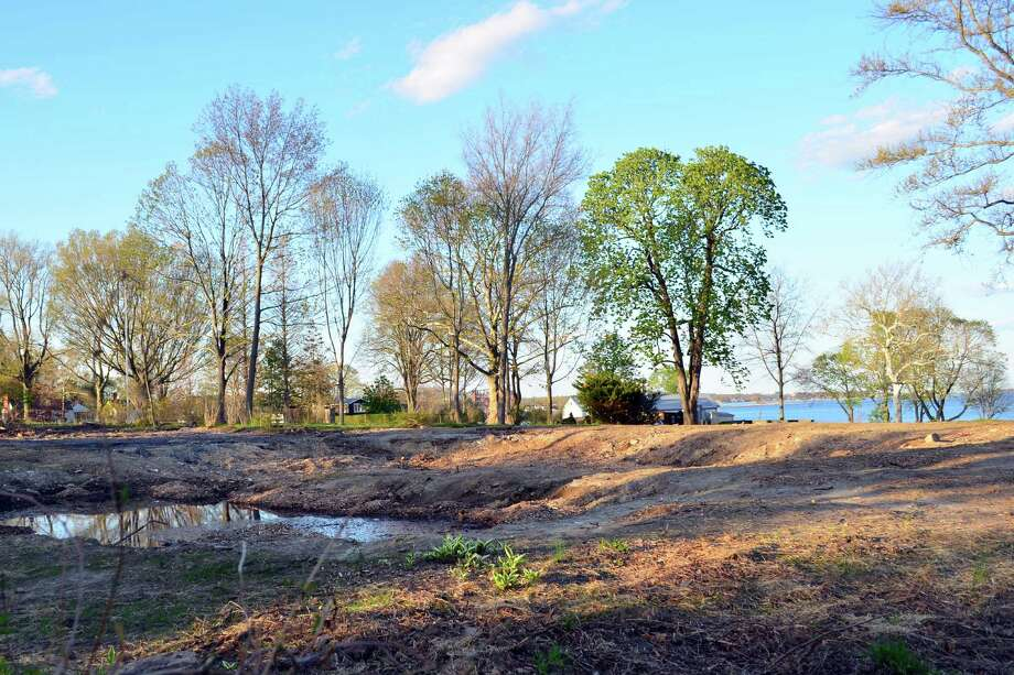 Nothing remains of Firwood, the home that stood at 203 Long Neck Point Road. The pool of water is where the pool once was. Photo: Megan Spicer / Darien News