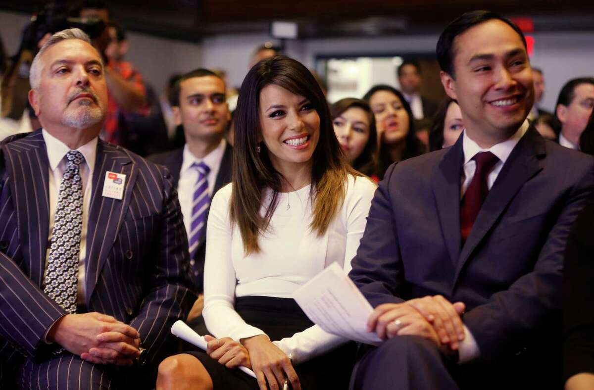 Actress Eva Longoria, center, Henry R. Munoz III, co-founder of the Latino Victory Project, left, and Rep. Joaquin Castro, D-Texas, are seated at an event launching The Latino Victory Project, a Latino political action committee, at the National Press Club in Washington, Monday, May 5, 2014. (AP Photo/Charles Dharapak)