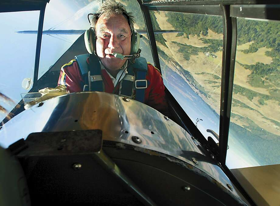 Eddie Andreini is seen in his Stearman biplane over the Santa Cruz Mountains in this file photo. Andreini died Sunday, May 4, 2014 in a crash during an air show at Travis Air Force Base. Photo: Michael Maloney, SFC