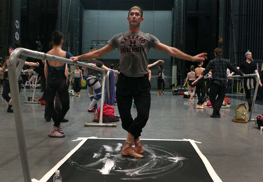 Retiring San Francisco Ballet principal dancer Damian Smith paints with his feet during a ballet class on the War Memorial Opera House stage in San Francisco. Photo: Paul Chinn, The Chronicle