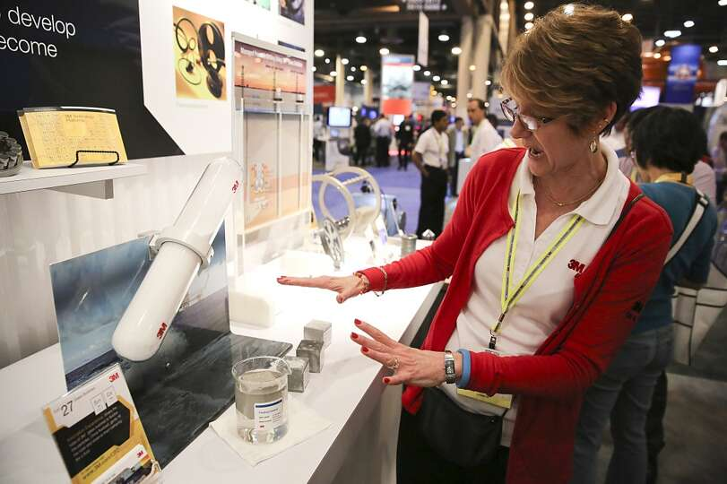 Cheri Hayne with 3M Oil and Gas gives a demonstration of a #M cement that floats on water on May 5,