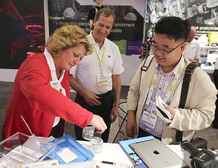 From left to right, , Jeff Tane with 3M and Chul Soo with Samsung Heavy Industry in Korea watch as T
