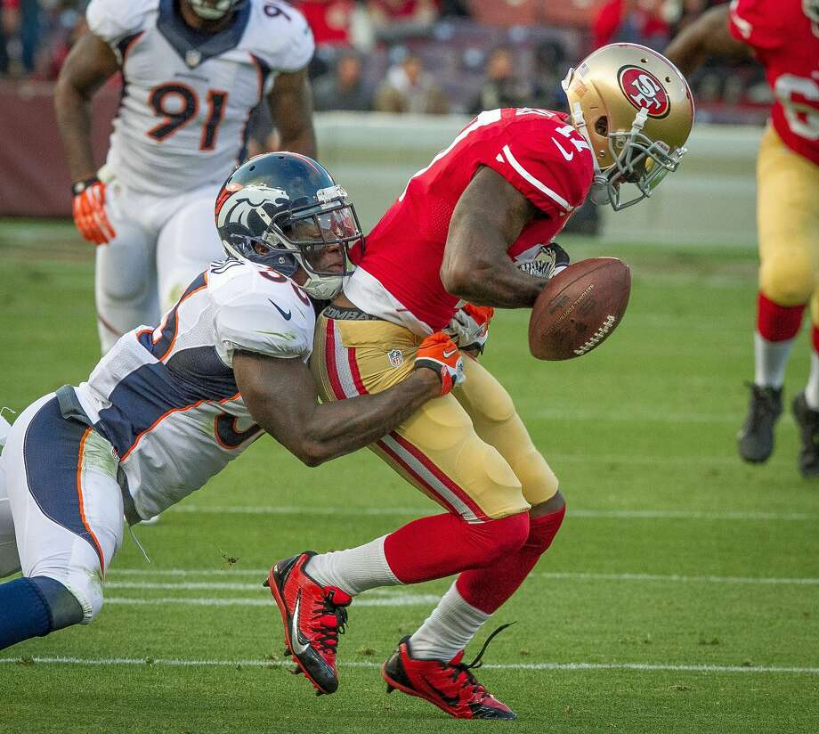 Denver's strong safety Duke Ihenacho forces 49ers receiver A.J. Jenkins to fumble at Candlestick Park on Thursday, August 8th, 2013. Jenkins was a notable bust with the 49ers. Photo: John Storey, Special To The Chronicle