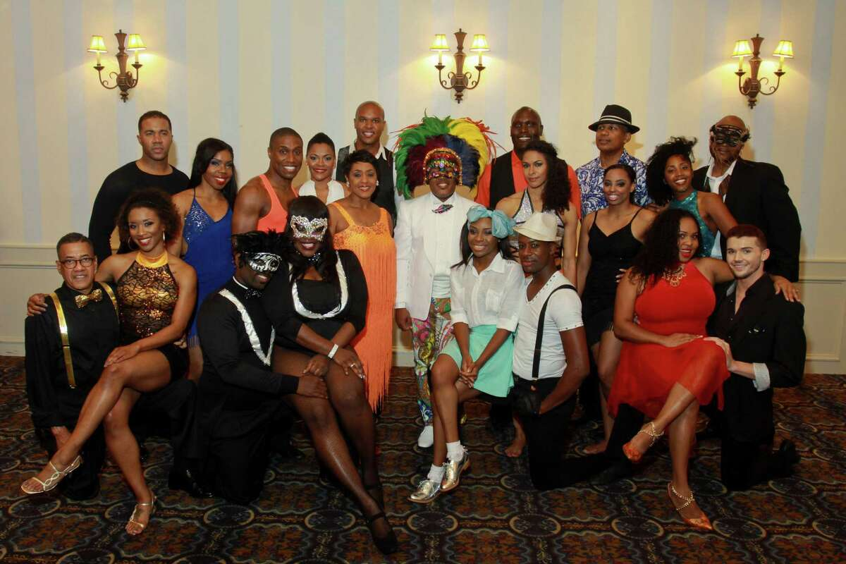 """(For the Chronicle/Gary Fountain, May 4, 2014) Dancers gather around Harrison Guy, founder and artistic director, center, before their competition at the Urban Souls Dance Company's 4th annual charity gala and fundraiser """"Dancing with the Houston Stars."""""""