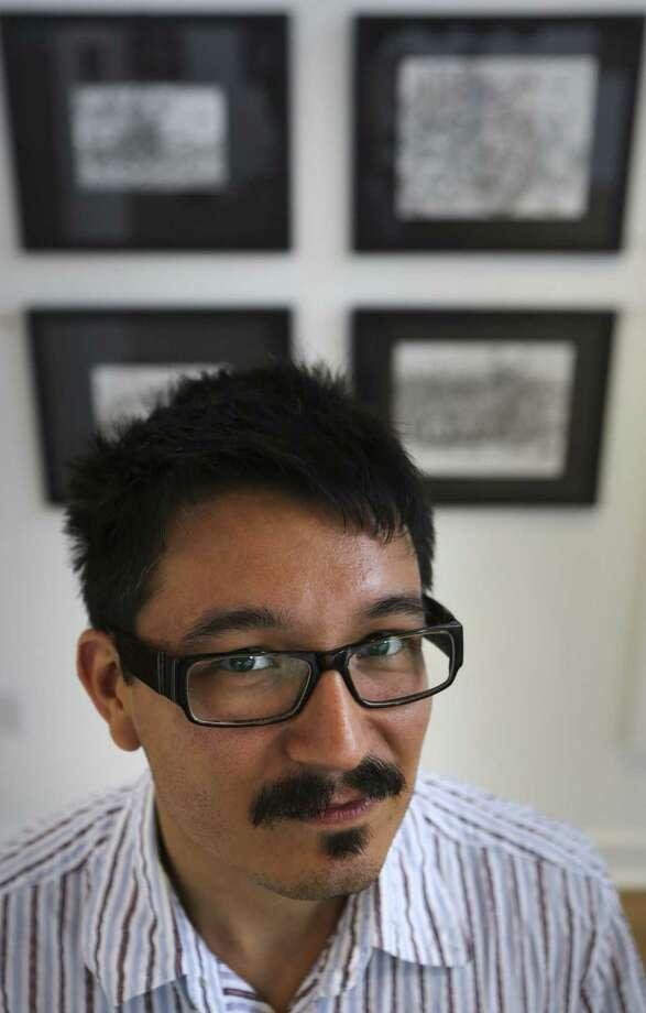 """""""La Chamba / Dirty Work"""", una exposición de dibujos y pinturas recientes de Albert Alvarez, está en exhibición en la galería Bihl Haus Arts. Photo: Bob Owen / San Antonio Express-News / ©2013 San Antonio Express-News"""