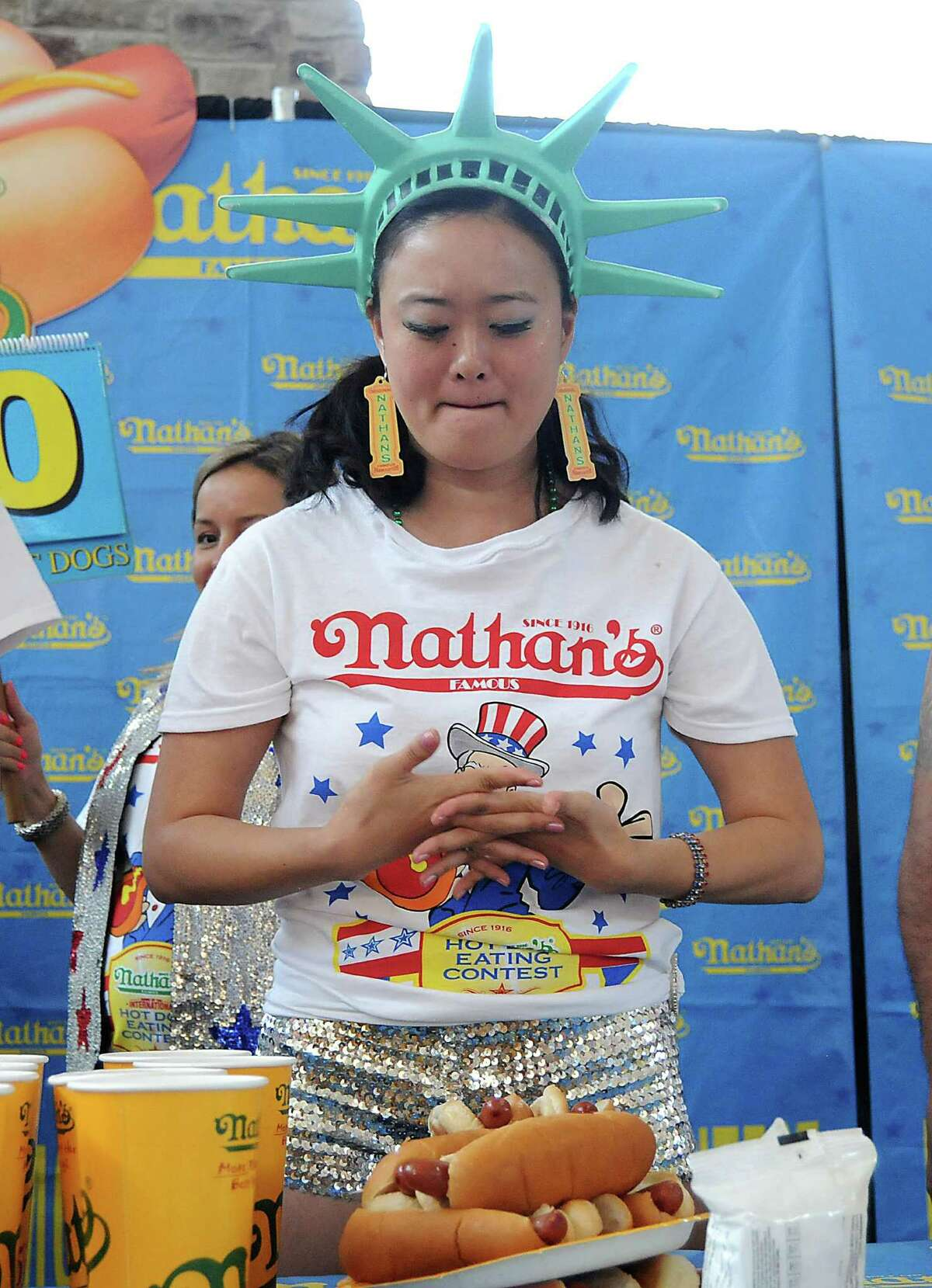 Mary Bowers takes a deep breath before the start of Saturday's hot-dog-eating contest at Memorial City Mall.