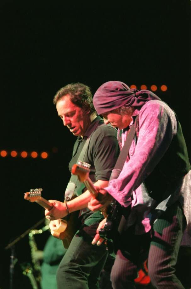 CONTACT FILED:  BRUCE SPRINGSTEEN  Bruce Springsteen, left, and 'Little' Stevie van Zandt on guitarplayed with the E Street Band reunion show at Compaq Center Tuesday April 18, 2000.      HOUCHRON CAPTION (04/20/2000):  Bruce Springsteen, left, and guitarist Steve Van Zandt and the rest of the E Street Band delivered a commanding threee-hour concert Tuesday at Compaq Center. HOUCHRON CAPTION (12/14/2000): THE YEAR'S BEST CONCERTS INCLUDE THOSE BY BRUCE SPRINGSTEEN, LEFT, WITH KERCHIEFED GUITARIST STEVEN VAN ZANDT. Photo: Houston Chronicle