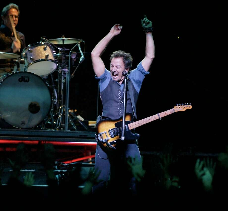 "Bruce Springsteen performs in concert with The E Street Band at the Compaq Center November 4,2002. James Nielsen (Special to the Chronicle)  HOUCHRON CAPTION (11/05/2002):  Bruce Springsteen, known as the Boss, sings with the E Street Band at the Compaq Center on Monday. His new album, ""The Rising,"" debuted at No. 1 in 11 countries, including the United States. Photo: Special To The Chronicle"