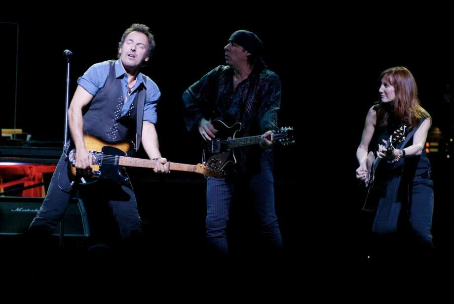 Bruce Springsteen (left) performs in concert with The E Street Band at the Compaq Center November 4,2002. James Nielsen (Special to the Chronicle Photo: Special To The Chronicle