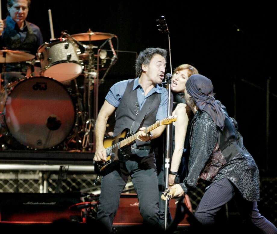 Bruce Springsteen (lower left) performs in concert with The E Street Band at the Compaq Center November 4,2002. James Nielsen (Special to the Chronicle Photo: Special To The Chronicle