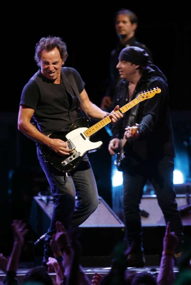 Bruce Springsteen, from left, and the E Street Band's Steven Van Zandt and Garry Tallent perform Monday, April 14, 2008, at the Toyota Center in Houston. Photo: Kevin Fujii, Houston Chronicle
