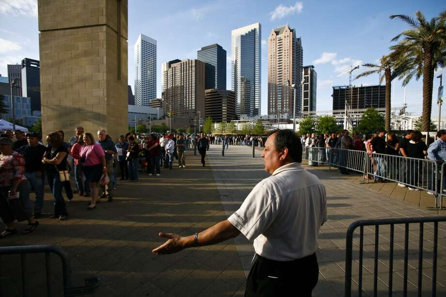 Thomas Trevizo directs concert goers before the start of the Bruce Springsteen concert at the Toyota Center Wednesday, April 8, 2009, in Houston. Photo: Michael Paulsen, Houston Chronicle