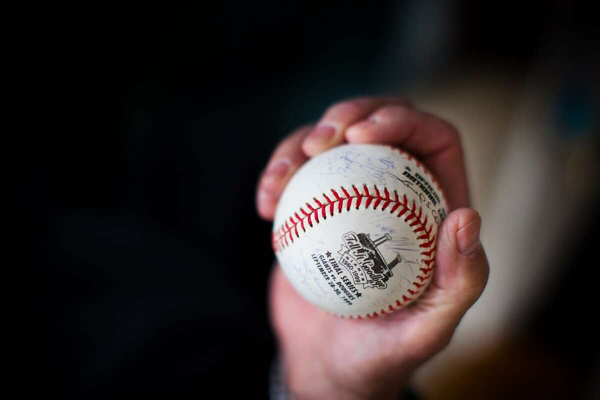 Bob Lurie, former owner of the Giants, holds a signed ball in his home in Atherton, Calif. on Monday, May 5, 2014.