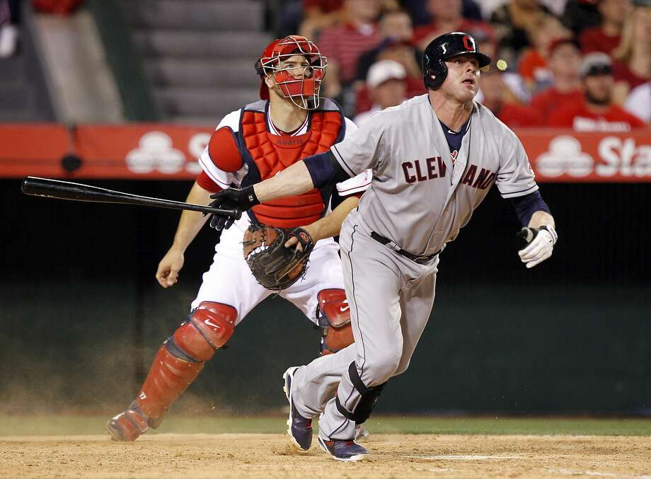 Jason Giambi makes contact with the ball against the Angels last week, but not for a hit. He's 0-for-10 this season, reaching base only when hit by a pitch. Photo: Alex Gallardo, Associated Press