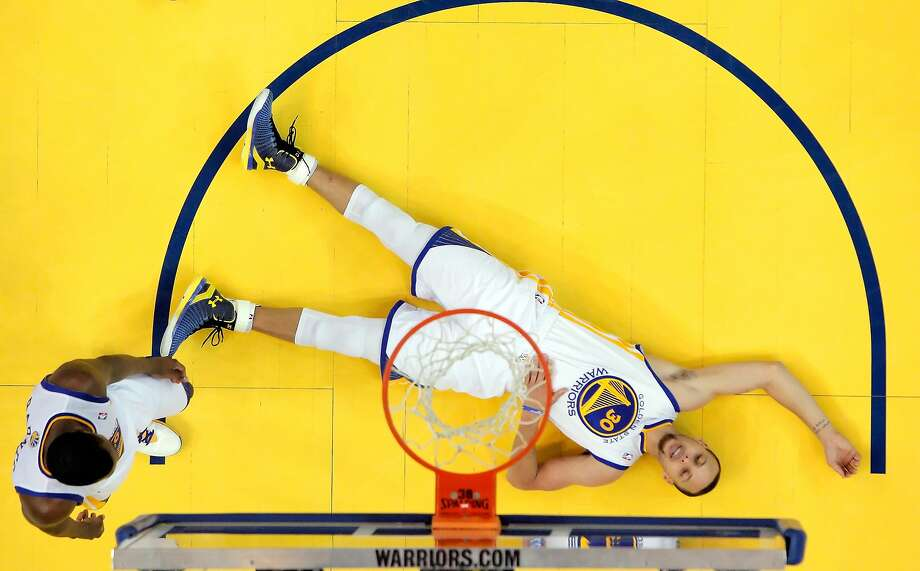 Stephen Curry (30) lies on the ground as he collects himself after hard contact with Chris Paul (3) and getting called for a foul in the second half as the Warriors defeated the Clippers 100-99. The Golden State Warriors played the Los Angeles Clippers at Oracle Arena in Oakland, Calif., on Thursday, May 1, 2014, in Game 6 of the NBA first round playoffs. Photo: Carlos Avila Gonzalez, The Chronicle