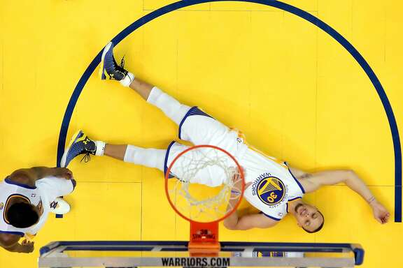 Stephen Curry (30) lies on the ground as he collects himself after hard contact with Chris Paul (3) and getting called for a foul in the second half as the Warriors defeated the Clippers 100-99. The Golden State Warriors played the Los Angeles Clippers at Oracle Arena in Oakland, Calif., on Thursday, May 1, 2014, in Game 6 of the NBA first round playoffs.