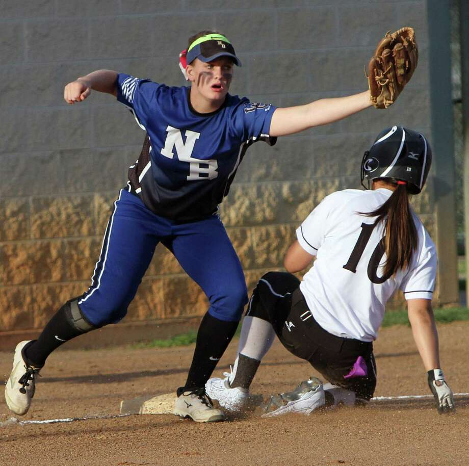 Steele's Savanna Bonola (10) slides safely into third during the Lady Knights' 15-4 win Friday. Photo: Greg Bell / For The Northeast Herald