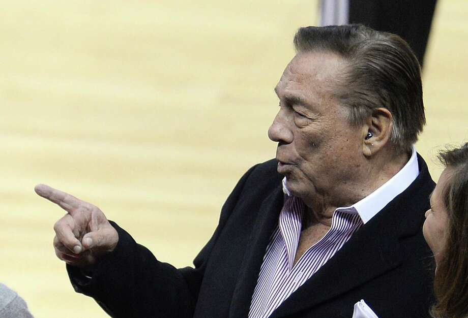 "Los Angeles Clippers owner Donald Sterling attends the NBA playoff game. The NBA banned Sterling for life for ""deeply offensive and harmful"" racist comments that sparked a national firestorm. The whole mess makes you want to take a long and hot shower. Photo: ROBYN BECK, AFP/Getty Images / AFP"