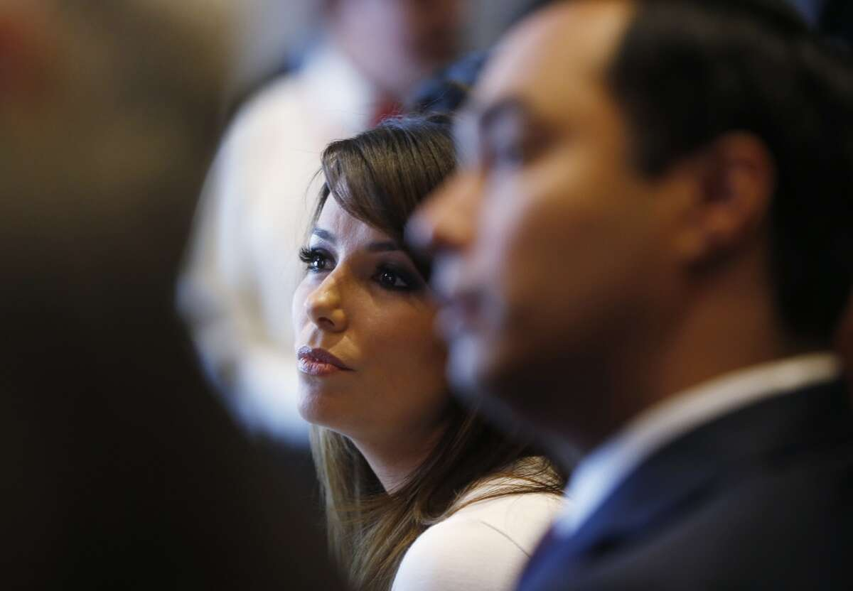 Actress Eva Longoria, left, is seated with Rep. Joaquin Castro, D-Texas, at an event launching The Latino Victory Project, a Latino political action committee, at the National Press Club in Washington, Monday, May 5, 2014.