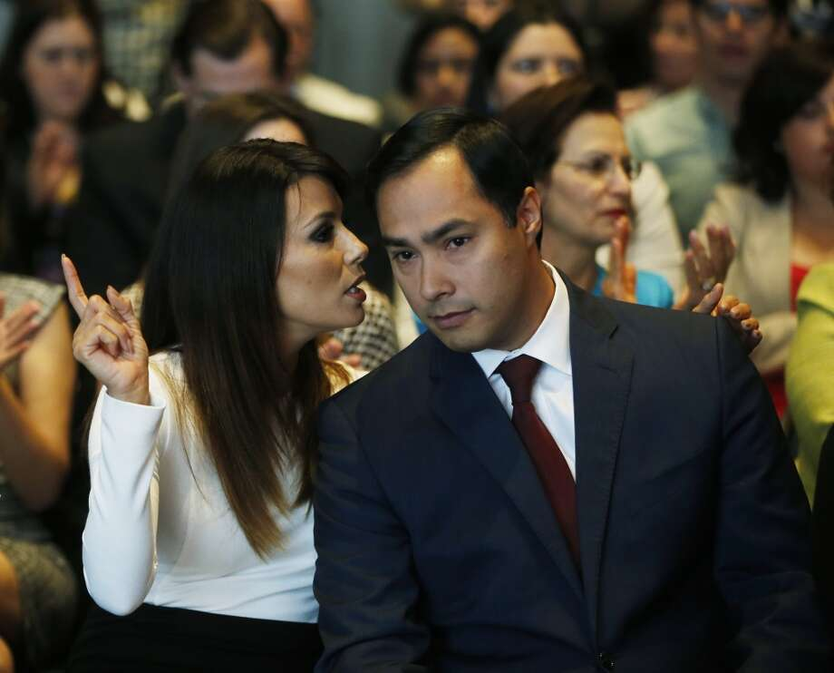 Actress Eva Longoria speaks with Rep. Joaquin Castro, D-Texas, at an event launching The Latino Victory Project, a Latino political action committee, at the National Press Club in Washington, Monday, May 5, 2014. Photo: Charles Dharapak, Associated Press