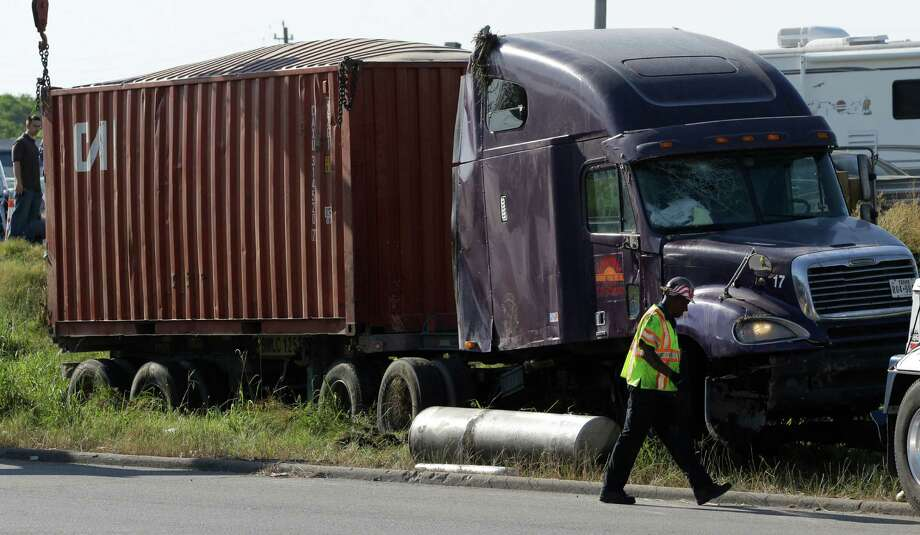 The 18-wheeler shut down two right lanes at I-10 and Mercury on Monday. Photo: J. Patric Schneider, For The Chronicle / © 2014 Houston Chronicle