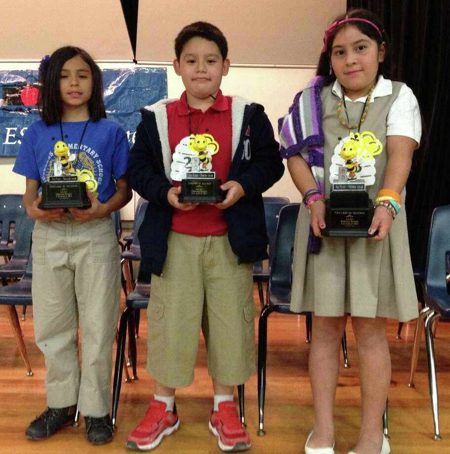 The San Antonio ISD's 13th Annual Spanish Spelling Bee Contest was held Saturday at the Irving Middle School auditorium. Shown left to right are the winners: Anel Carrillo, Douglass Elementary, second place; Felipe Benavente, Steele Elementary, third place; and Paola Jauregui, Highland Park Elementary, first place. More than 30 elementary schools sent their champions to the competition. Photo: San Antonio Express-News