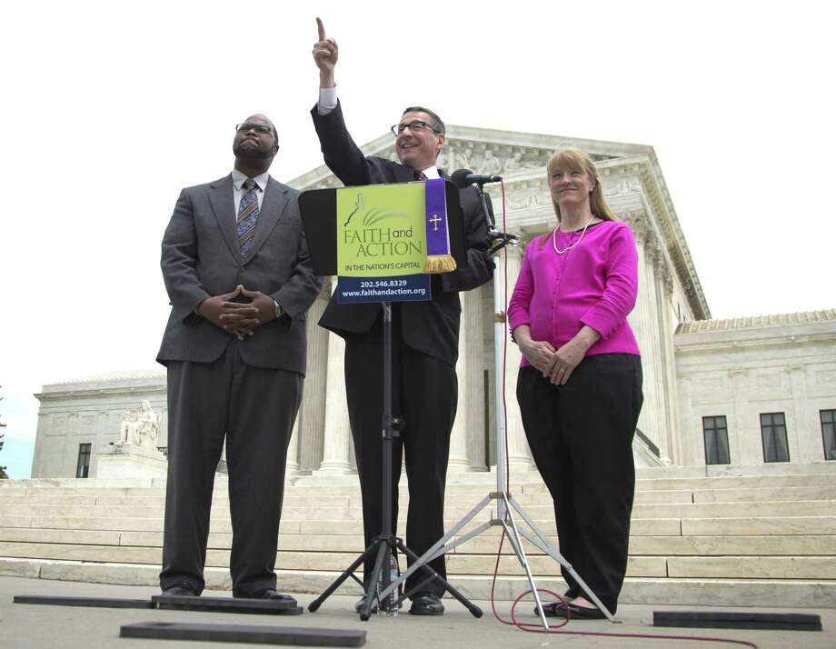 The Rev. Rob Schenck (center), of Faith and Action, and two colleagues are aligned with the high court's majority decision. Photo: Associated Press / AP