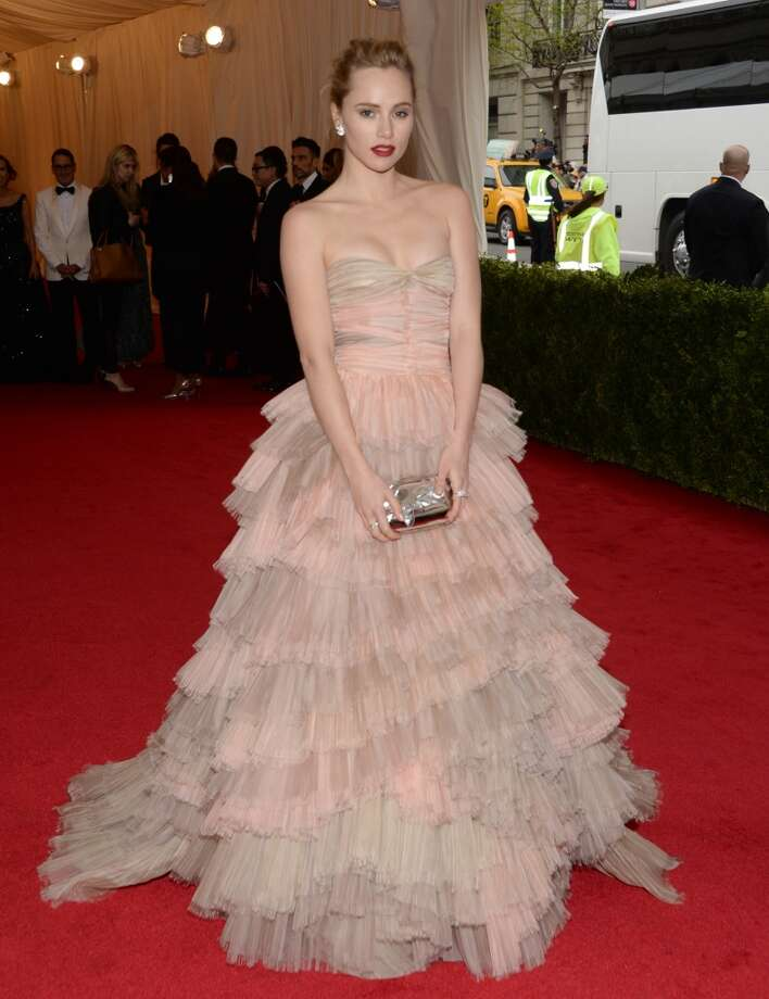 "British model and actress Suki Waterhouse attends The Metropolitan Museum of Art's Costume Institute benefit gala celebrating ""Charles James: Beyond Fashion"" on Monday, May 5, 2014, in New York. Photo: Evan Agostini, Associated Press"