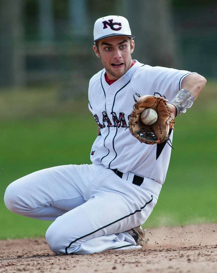 New Canaan high school shortstop Matt Toth fields an infield ground ball during a baseball game against Staples high school played at Mead Park, New Canaan, CT on Monday, May, 5th, 2014. Photo: Mark Conrad / Connecticut Post Freelance