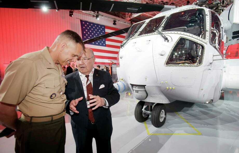 "Sergei Sikorsky, second from left, son of company founder Igor Sikorsky, chats with U.S. Marine Brigadier General Matthew G. Glavy after the unveiling of the Sikorsky CH-53K heavy lift helicopter, right, during an official rollout, Monday, May 5, 2014, at the Sikorsky Aircraft Corporation in Jupiter, Fla. The CH-53K, named the ""King Stallion,"" is one of the first all-digitally designed helicopters, and will replace the CH-53E ""Super Stallion"" helicopter for the U.S. Marine Corps. beginning in 2019. The first flight of a CH-53K is planned for later this year. (AP Photo/Wilfredo Lee) Photo: Wilfredo Lee, Associated Press / Associated Press"