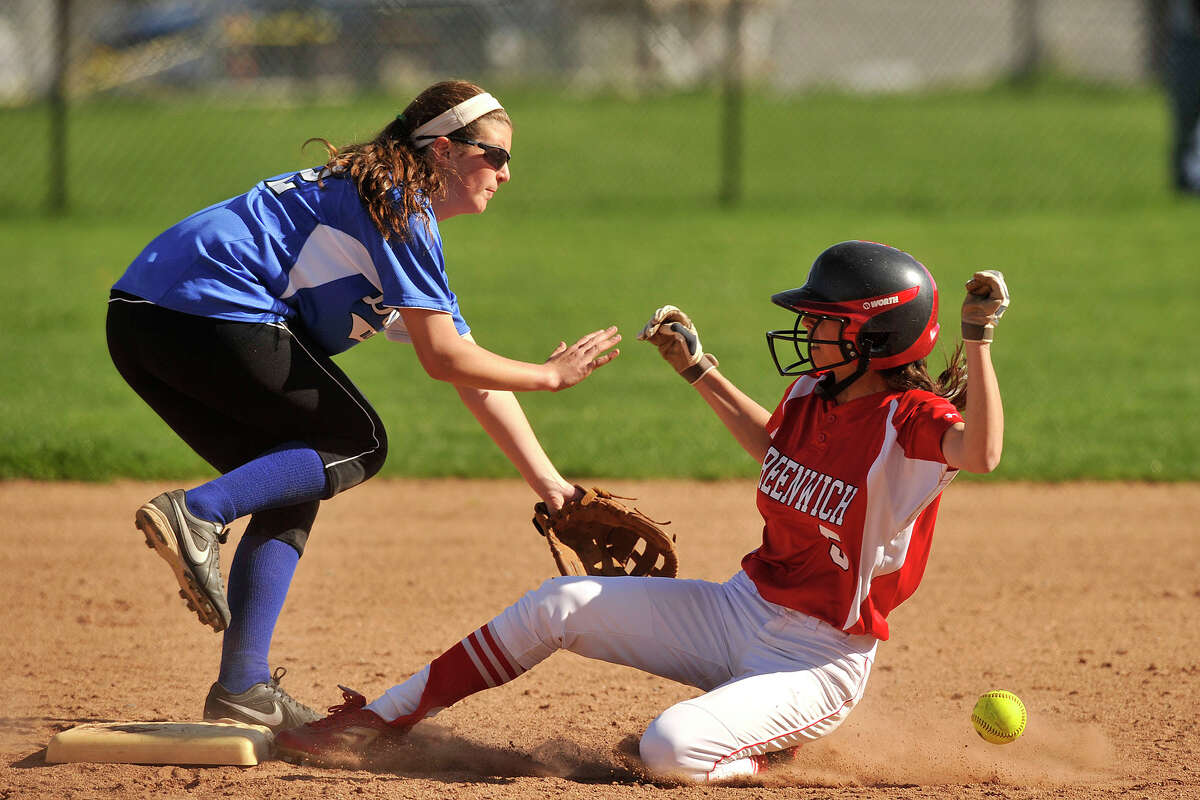 Greenwich's Jennifer Ambrogio slides safely into second base beating the tag of Darien shortstop Cassidy Schiff during their game at Greenwich High School in Greenwich, Conn., on Monday, May 5, 2014. Darien defeated Greenwich, 6-0.